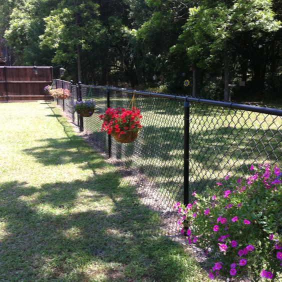 Flowers Hung on Chain Link Fence