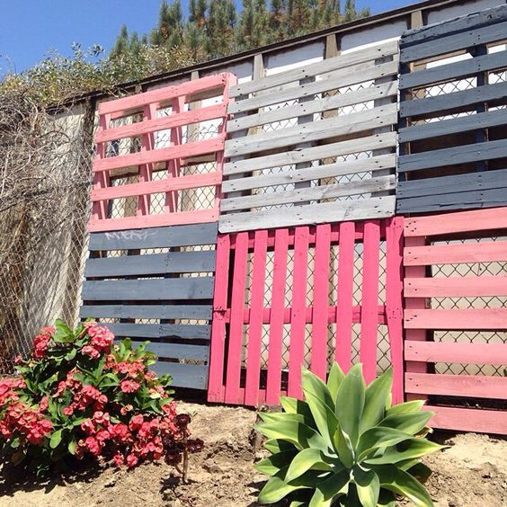 Painted Pallets on Fence