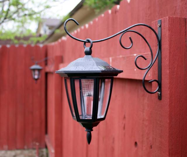 Solar Lights on Red Fence