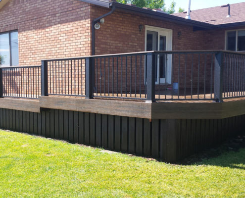 Trex Transcend Spiced Rum Deck with IronGuard Railinng, Black Posts,and Deck Skirting