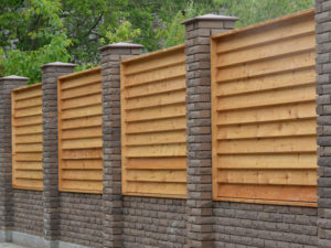 Horizontal wood and stone fence